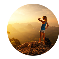 Hiker on mountain looking at the sunrise